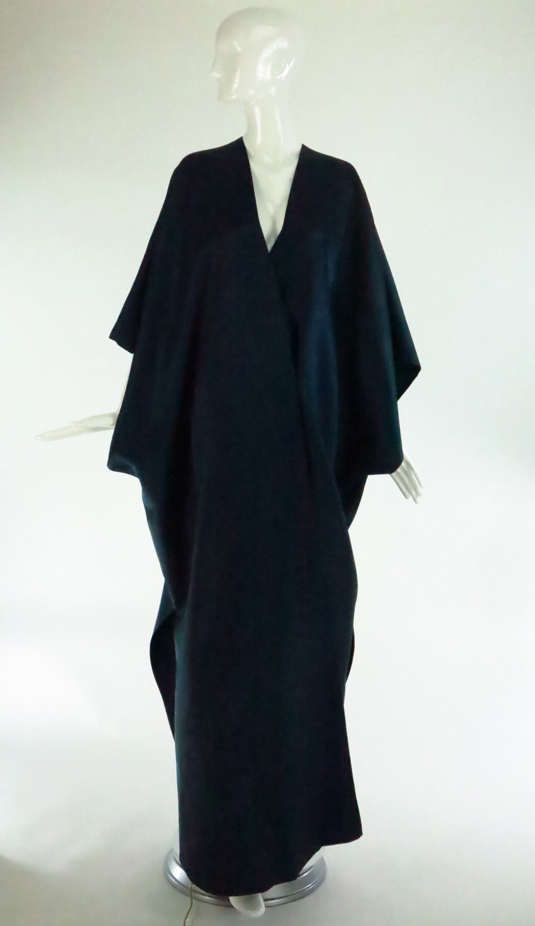 Stavropoulos was known for his  simple and clean line design, the clothing spoke for itself with the elegance it conveyed and in his time he had a loyal following Elizabeth Taylor being one...An evening coat of deep teal blue silk twill is a