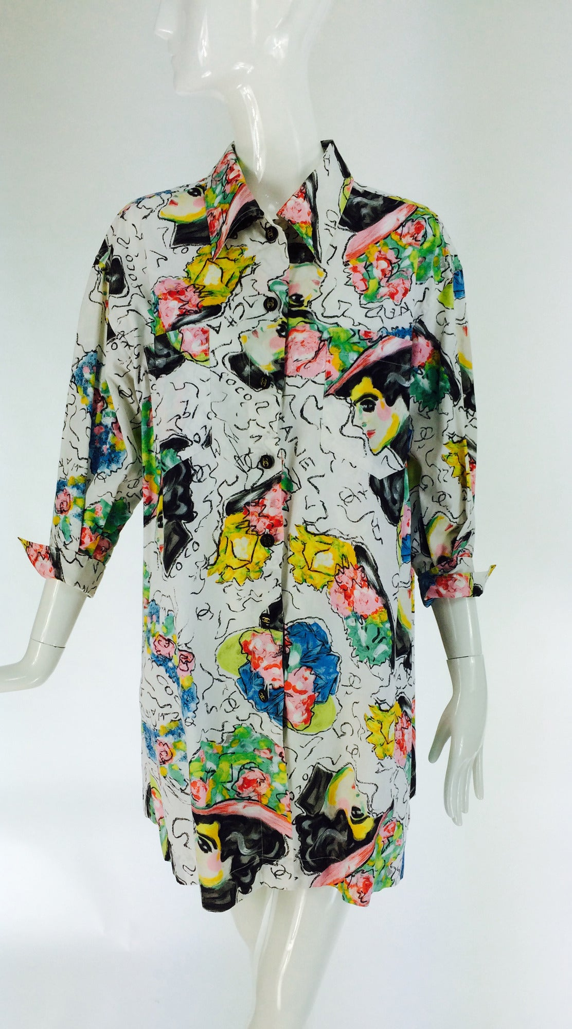 Colourful painterly printed cotton big shirt/tunic with illustrations of Coco Chanel...Profile of Chanel circa early 1900s wearing a hat appear throughout...Button front shirt has a collar, yoke back, dropped shoulders, 3/4 length sleeves with