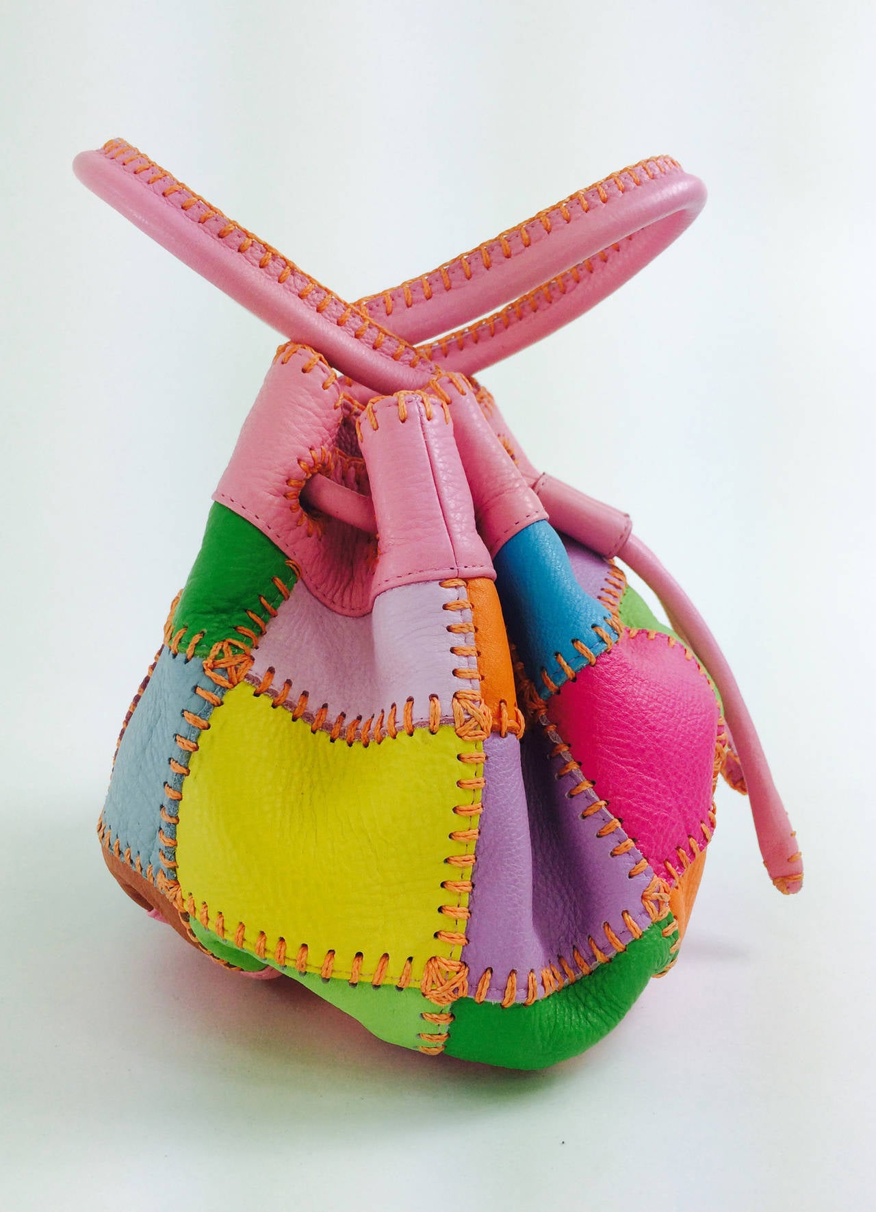 Hand stitched, soft pebble leather, double handle day bag from Carlos Falchi, looks barely if ever used...The leather is summery bright colours...Hand stitched details...Double handles...The bag closes with a drawcord...Fully lined in signature