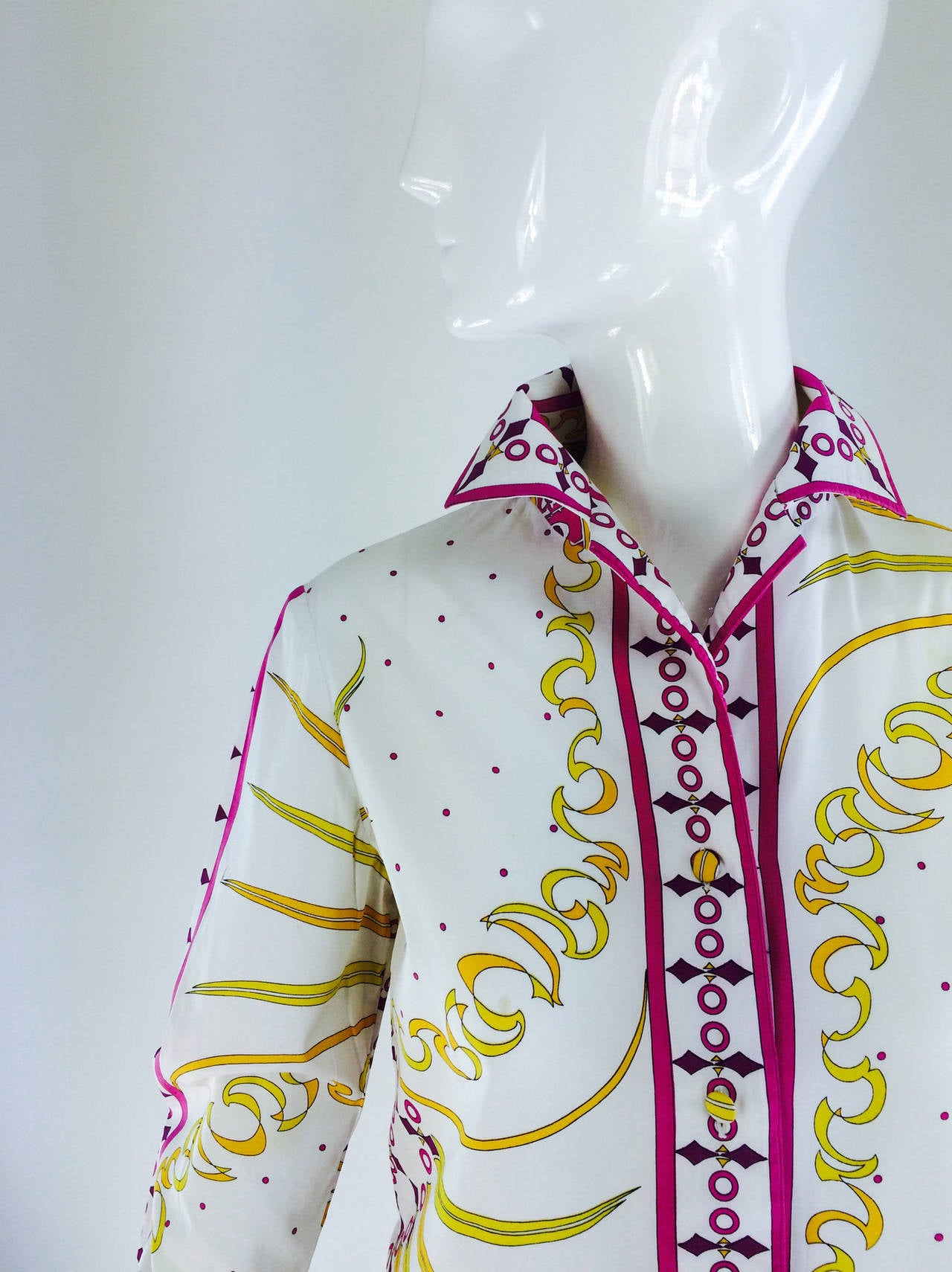 Pucci cotton print blouse & skirt set 1960st...Crisp white cotton with hot pink, yellow, purple and black print of ribbons, stars & wild looking birds...The long sleeve blouse buttons at the front and cuffs with self buttons (extra buttons