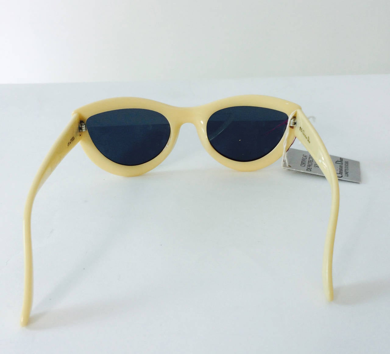 Christian Dior Lunettes De Soleil sunglasses from the 1970s never worn with the original tags...Ivory frames...Modified cat eye frames have original lenses...Made In Austria excellent condition...