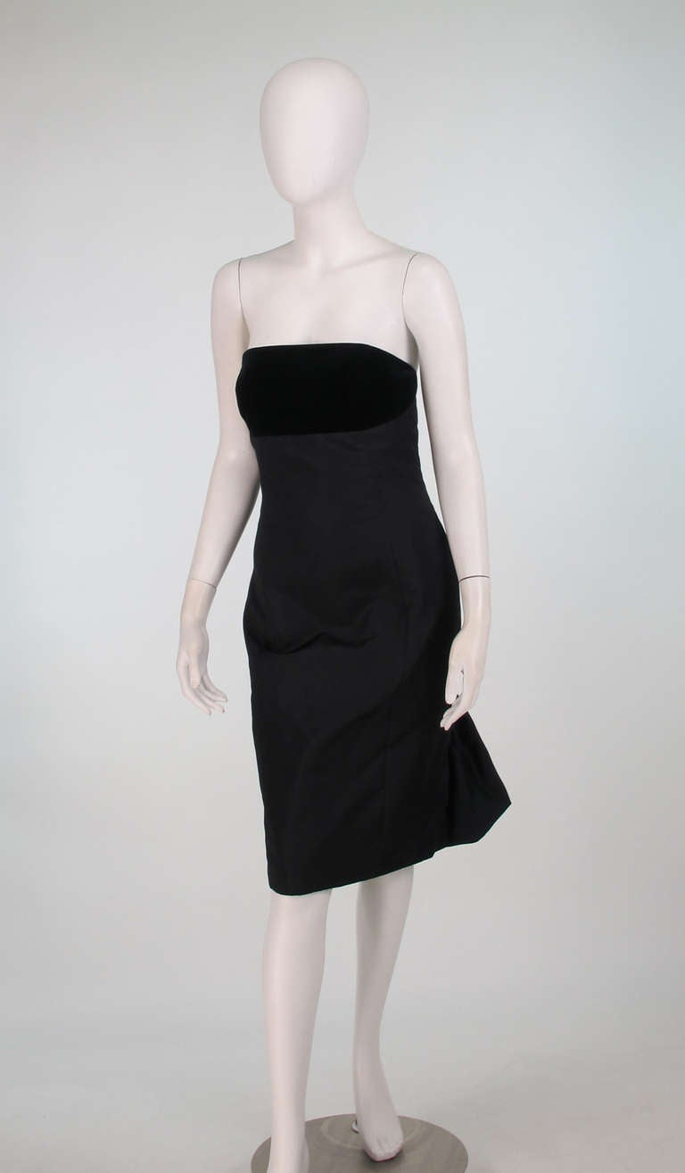 1990s Escada black silk/velvet, bubble tail cocktail dress...Strapless dress has an inset velvet front bodice...Body of dress is black silk...Fitted through the waist and hips...The back of the dress is gathered under the derriere and forms a bubble