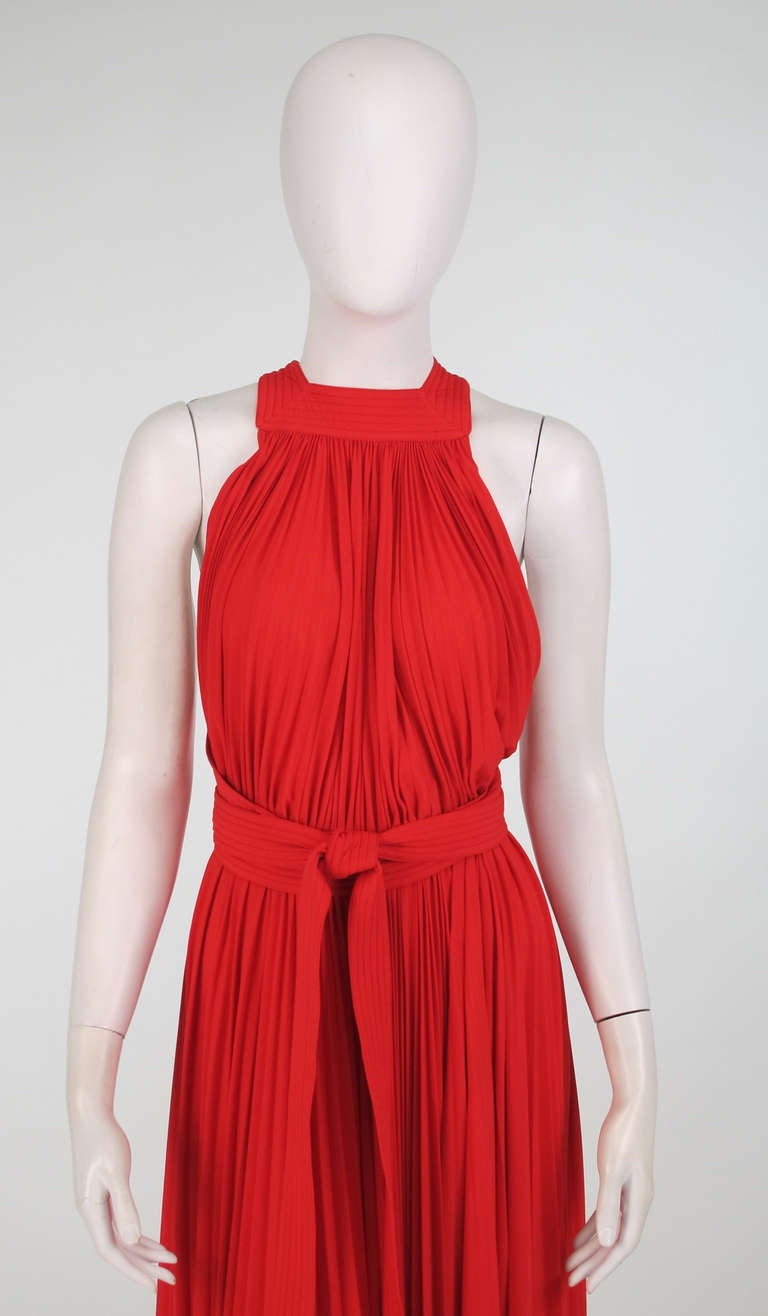 1960s Adele Simpson tomato red halter neck pleated maxi dress...The pleated bodice has wide straps that are stitch quilted, they cross at the back and wrap around the waist...Unlined, it closes at the waist back with a bar hook and snaps...Long