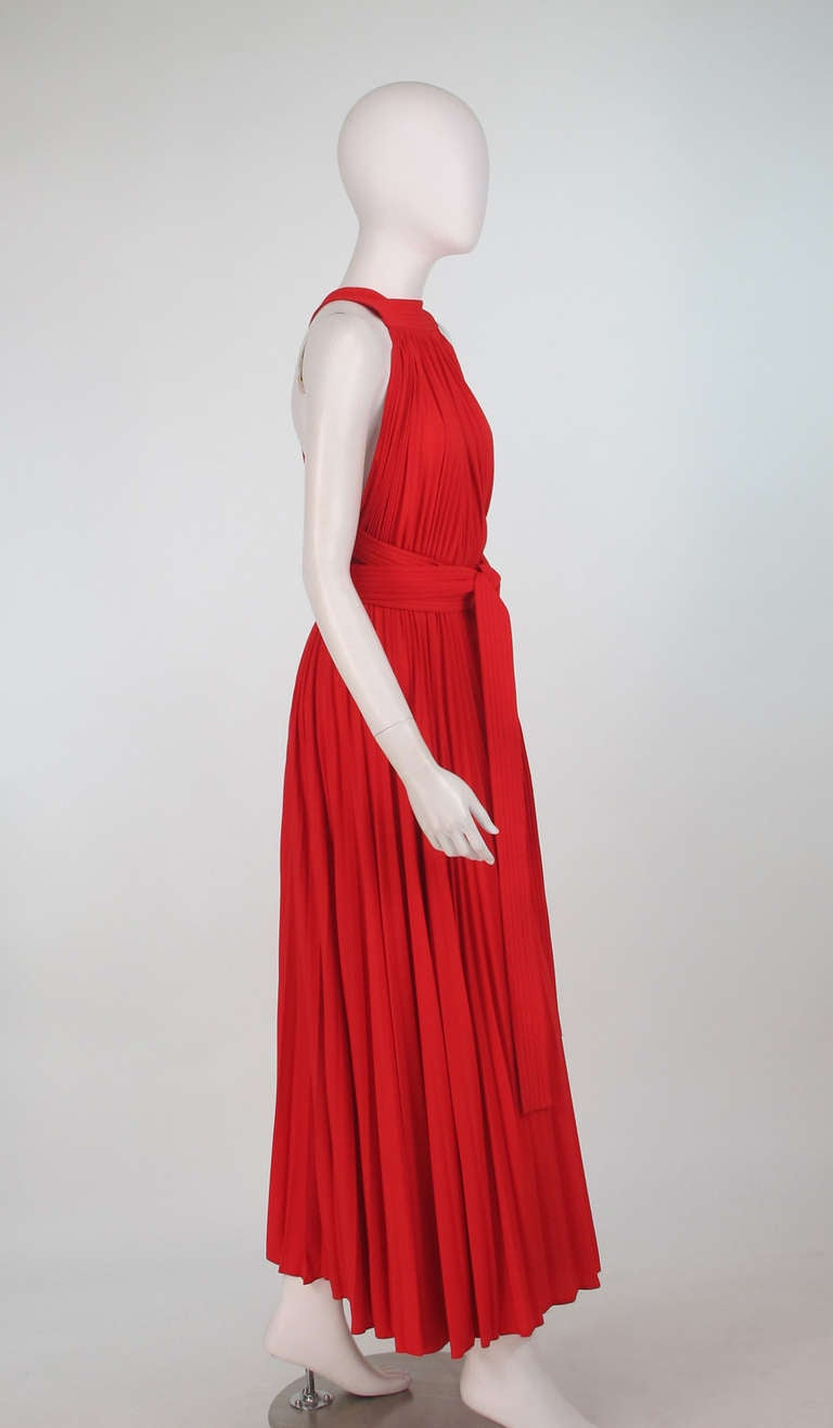 Women's 1960s Adele Simpson tomato red halter neck pleated maxi dress For Sale
