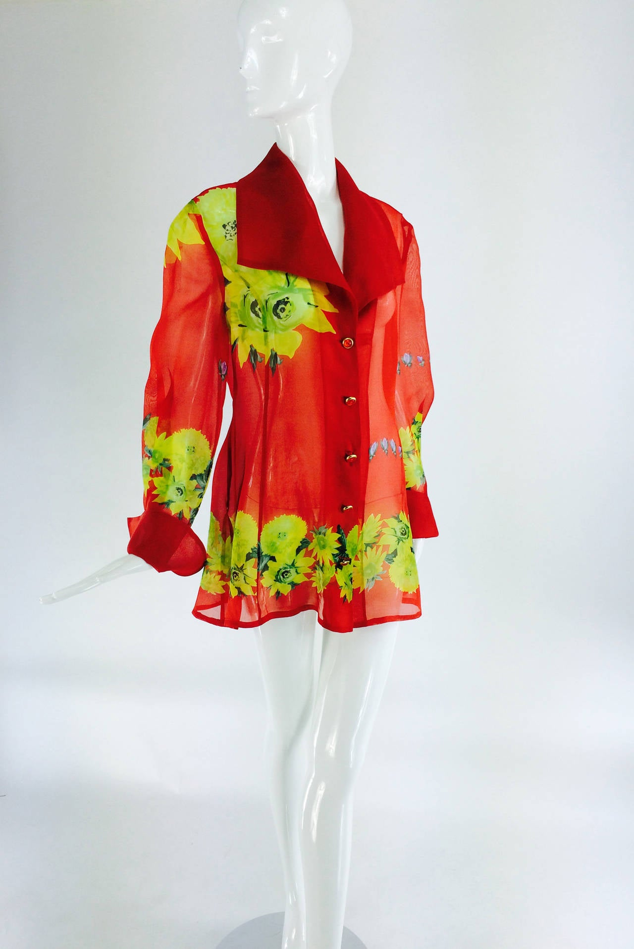 Christian Llinares France floral organza blouse 1980s...Tomato red ground with large floral print...Blouse closes at the front with red and gold buttons, wide collar, fitted through the waist and flaring at the hip, center back and side hem vents,