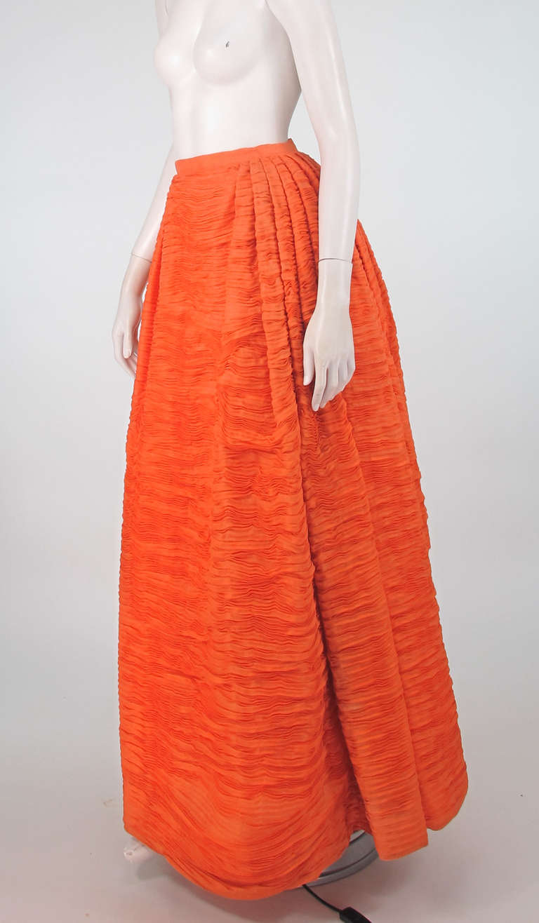 Sybil Connolly's trademark was pleated linen, a labour intensive process, where up to nine yards of fine Irish handkerchief linen was hand pleated resulting in one yard of exquisite fabric…The pleats were set horizontally which gave her dresses and