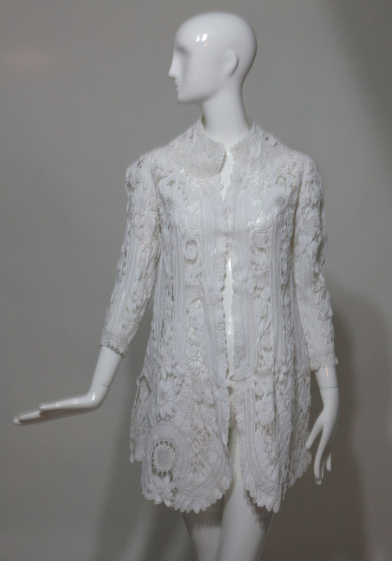 Battenburg Victorian white tape lace coat...Beautiful white lace coat from the late 1800s, white cotton floral tape lace design below hip length coat has bracelet length sleeves, an open front, stand up collar/neckline, slightly fitted through the