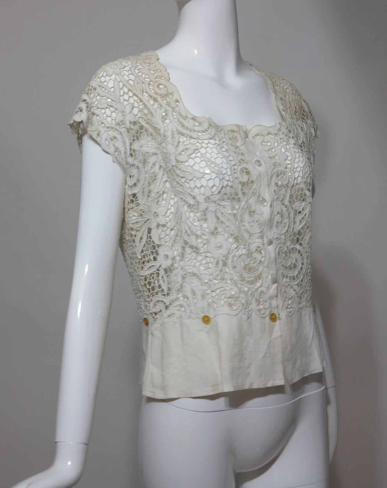 Madeira hand made cut work embroidered lace blouse in off white from the 1950s...This blouse is completely embroidered by hand using a buttonhole stitch outlining each opening cut in the fabric, the fabric is medium weight linen...This beautiful