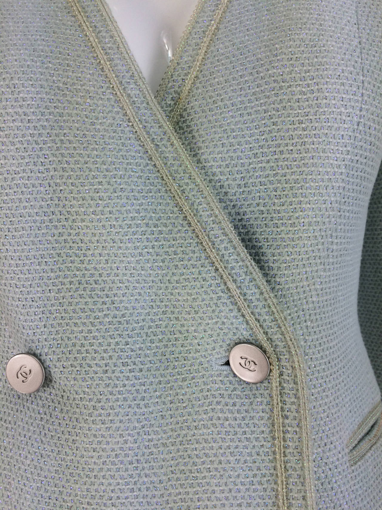 Chanel mint green glitter tweed cropped jacket 2000...Cropped jacket closes at the front with double buttons at the waist...V front...Long sleeves with button cuffs...Front faux pockets with banded trim...Marked size 36...Freshly dry cleaned and