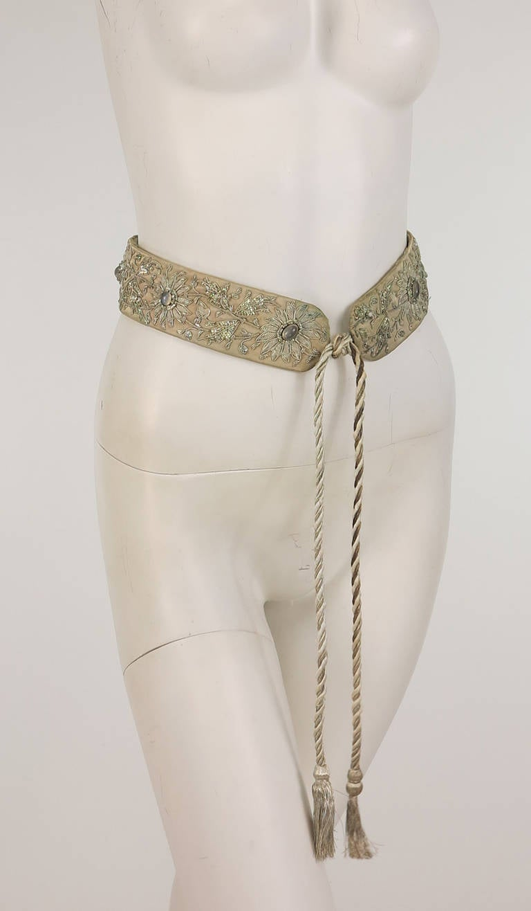 1960s India silver metallic embroidered belt with bezel set semi precious stones, possibly moonstones...The wide belt is heavily embroidered in silver thread in a foliate design, the flowers are set with oval cabochon stones, possibly