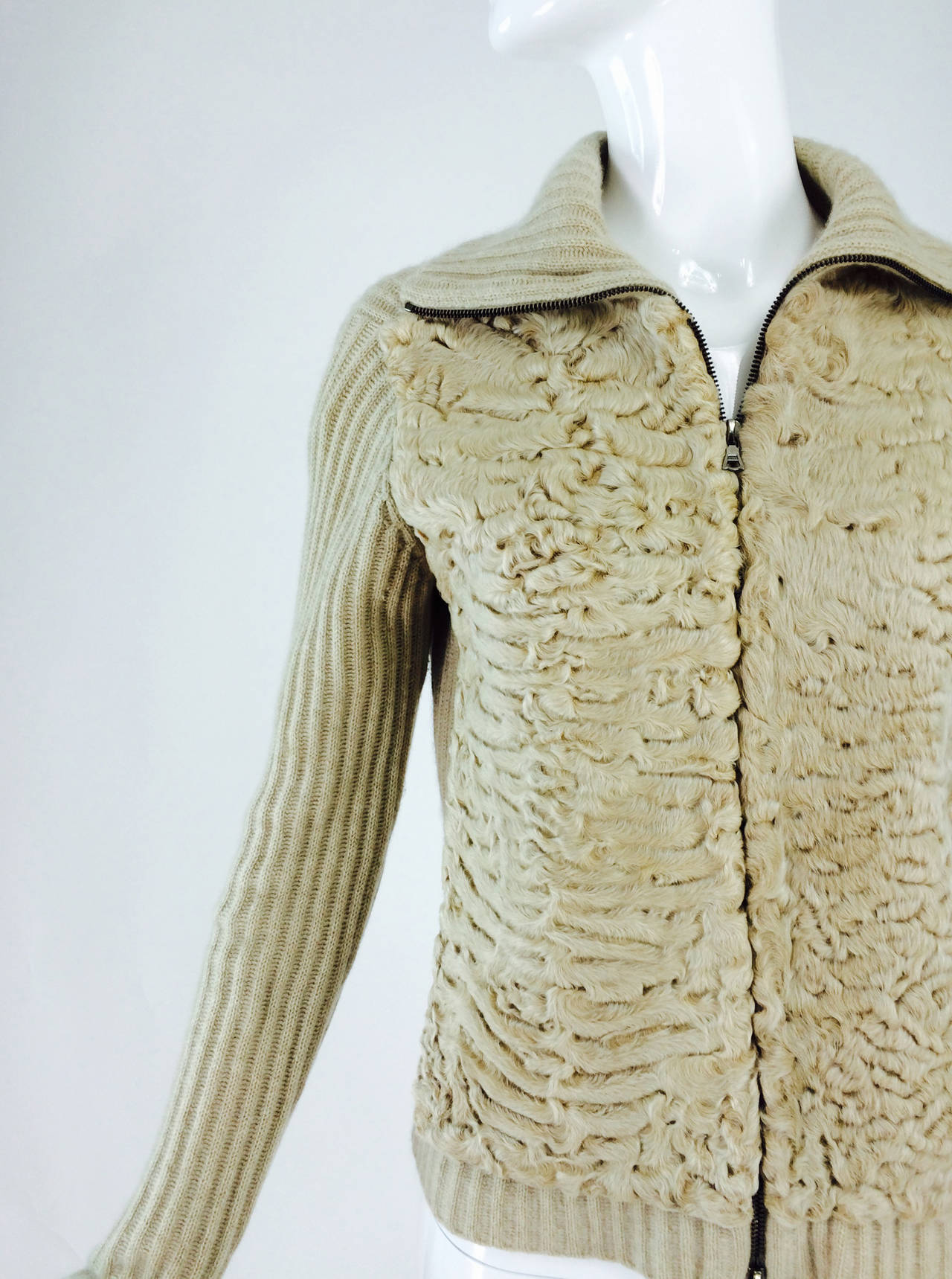 TSE beige cashmere & karakul zip front sweater jacket...Ribbed sweater with side fronts of blond karakul lamb...The zip front forms a turtle neck with closed completely...Unlined...Fits like a Small-Medium...