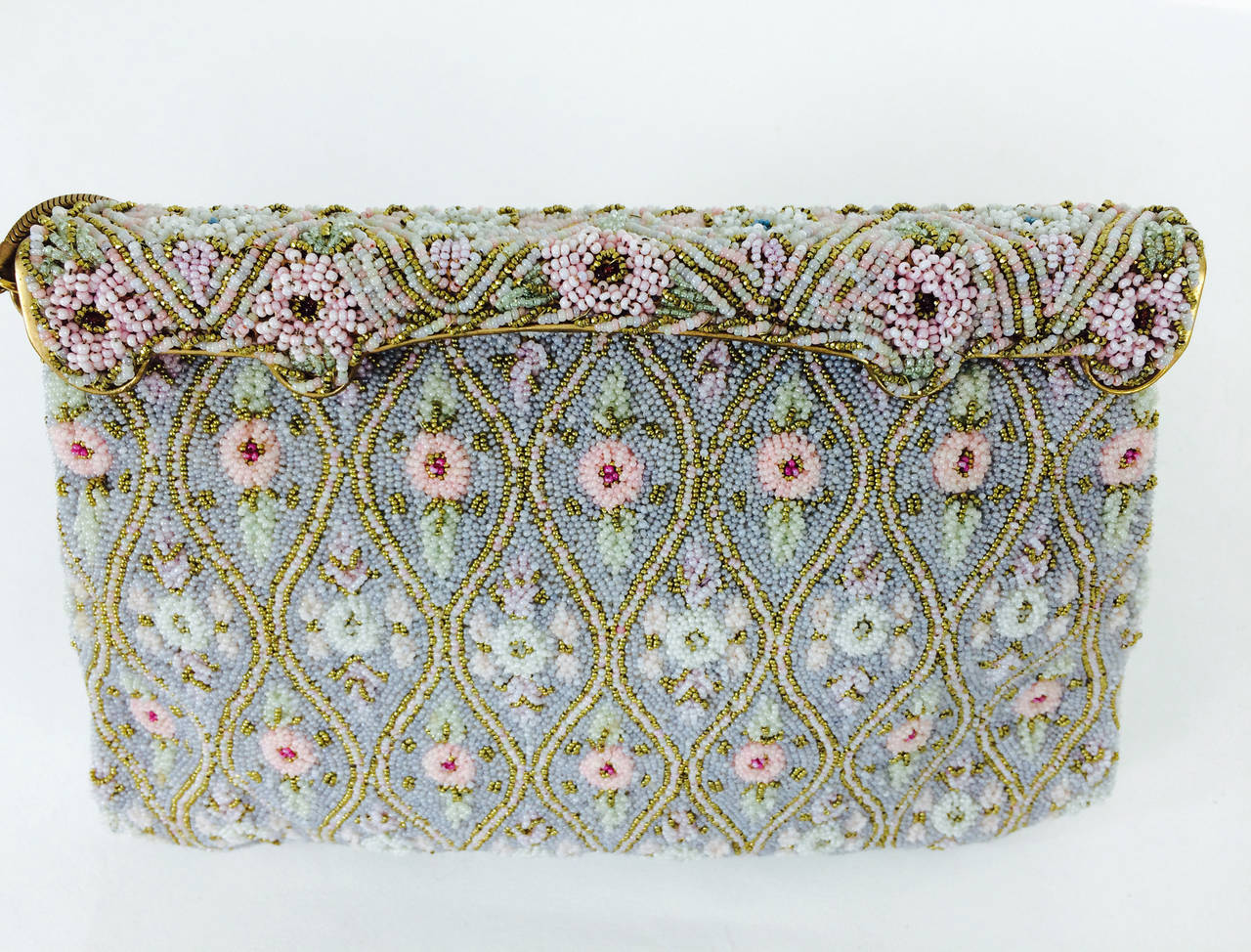 Caviar beaded floral design evening bag made in France 1950s...Beautiful pastel beaded bag in soft pinks, ivory and gold...The bag is completely hand beaded, with a beaded snap closure frame...Lined in off white satin with 2 open compartments each