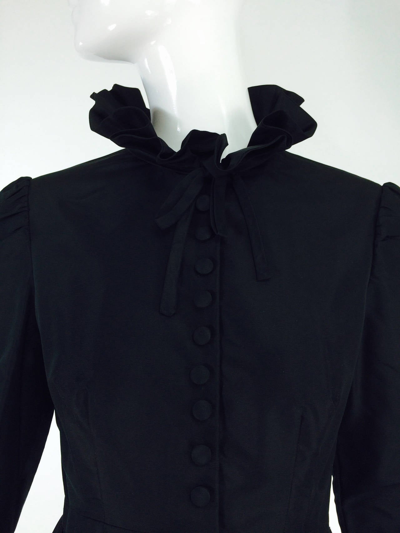 Shannon Rodgers for Jerry Silverman black Victorian style gown 1960s...High neck black taffeta gown from the early 1960s...Long sleeve fitted bodice gown has button detail front with narrow bow tie at the stand up ruffle collar...The sleeves are