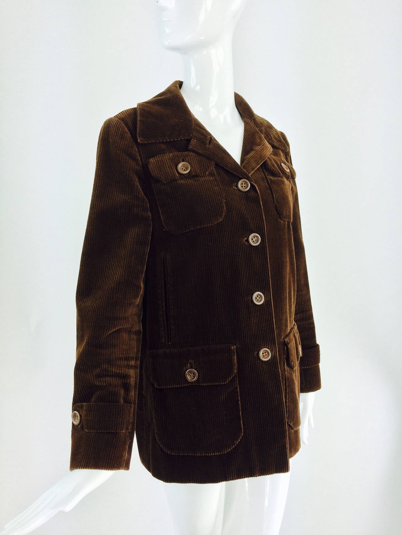 Bill Blass chocolate brown corduroy jacket early 1970s...Soft chocolate brown corduroy jacket has four flap patch pockets and vertical hand warmer pockets at the front sides...Single breasted jacket closes at the front with wooden buttons...Long
