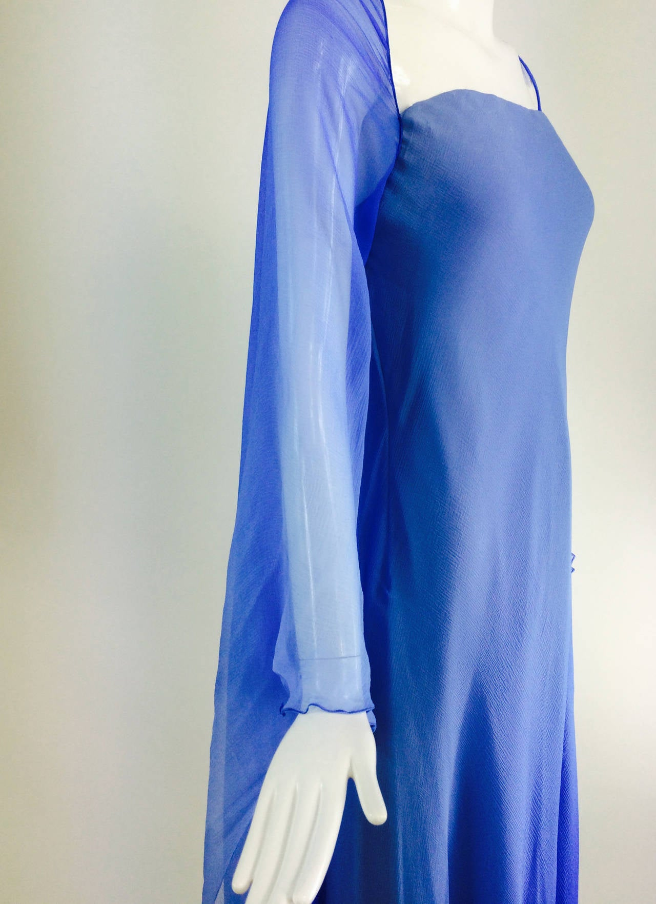 Fiandaca Cerulean Blue tonal silk chiffon gown 1990s...Goddess style gown in graded shades of cerulean blue silk chiffon with an attached chiffon bat wing cape...The strapless gown is fitted through the torso and flares to the hem...An attached