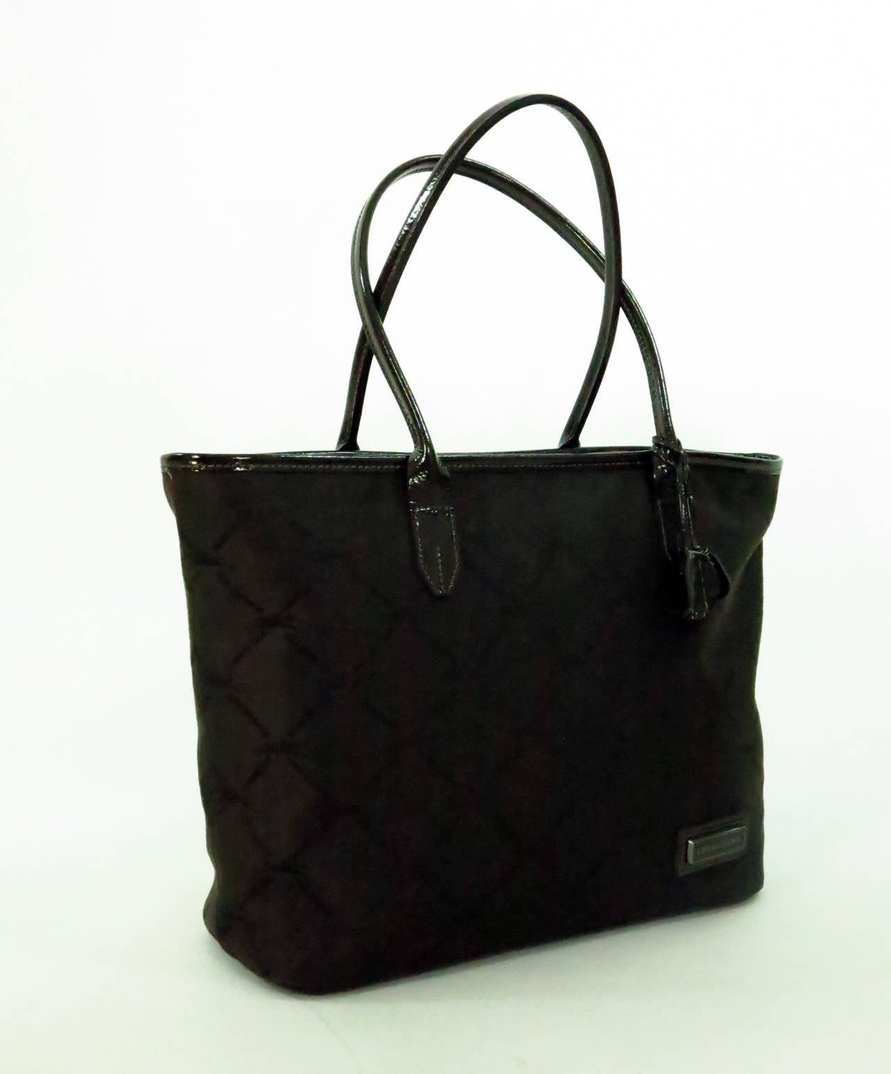 b3ba7b80d2 Longchamp double handle tote bag in chocolate brown patent leather & logo  fabric.