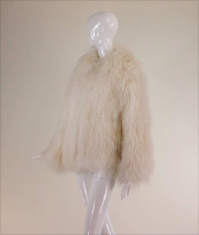 Mongolian lamb fur jacket in white Marvin Richards 1980s Unworn...Beautiful silky soft white Mongolian lamb fur jacket from the 1980s labeled Marvin Richards...Closes at the front with fur hooks...This coat is unworn and in excellent condition, the