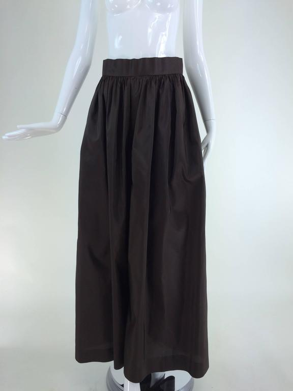 Bill Blass dark chocolate brown silk palazzo pant 1970s...Light weight silk that gently rustles when you walk...Wide band waist that sits at the natural waist, gathered pant with banded set in side pockets (see photo), the legs are wide and look