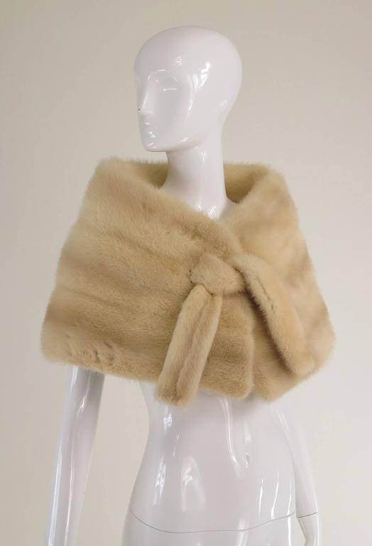 Gunther Jaeckel Furs Bonwit Teller champagne mink tie front cape 1960s...A lovely little cape that would be perfect for a wedding or other big event!  Champagne colour cape closes at the front with hooks and fur ties...Beautifully lined in silk with