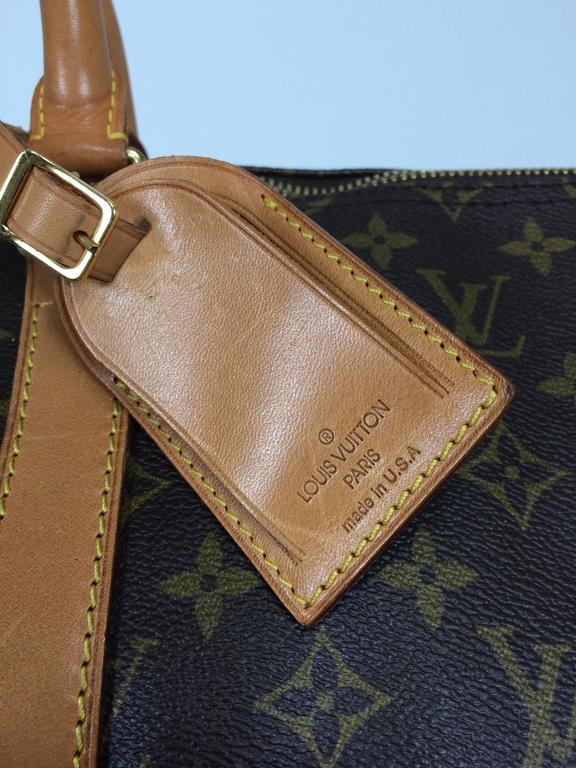 Louis Vuitton Keepall 55...The perfect weekend bag...In excellent pre-owned condition...Has the original Louis Vuitton luggage tag...Very clean inside...See photos for minor wear...
