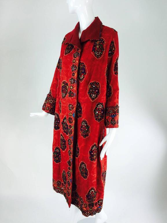 1920s Shisha (mirror embroidery) embroidered flapper style coat India...Beautifully embroidered coat done on a cotton damask fabric in a pomegranate colour...Embroidered medallions are scattered throughout the coat and are done in a fine buttonhole