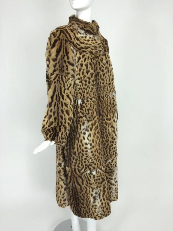 Full length spotted fur coat Yorn Boutique, Germany...Beautiful coat with yoke shoulder, stand up collar and long semi full sleeves that taper at the wrist...The coat closes at the front with fur hooks, it is fully lined and in excellent supple
