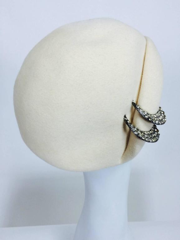 From the 1960s a cream wool cocktail hat with rhinestone trim...side rolled brim...fabric is marked Halson...Labeled Halston....