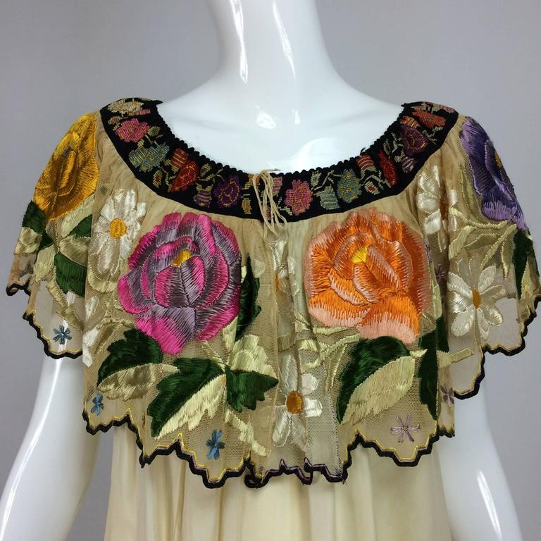 Vintage Mexican silk needlepoint & embroidered peasant blouse 1940s...From the 1940s this blouse is a tribute to the embroiderers art, starting at the neckline, there is a wide band of black needle point with brightly coloured flowers (there is a