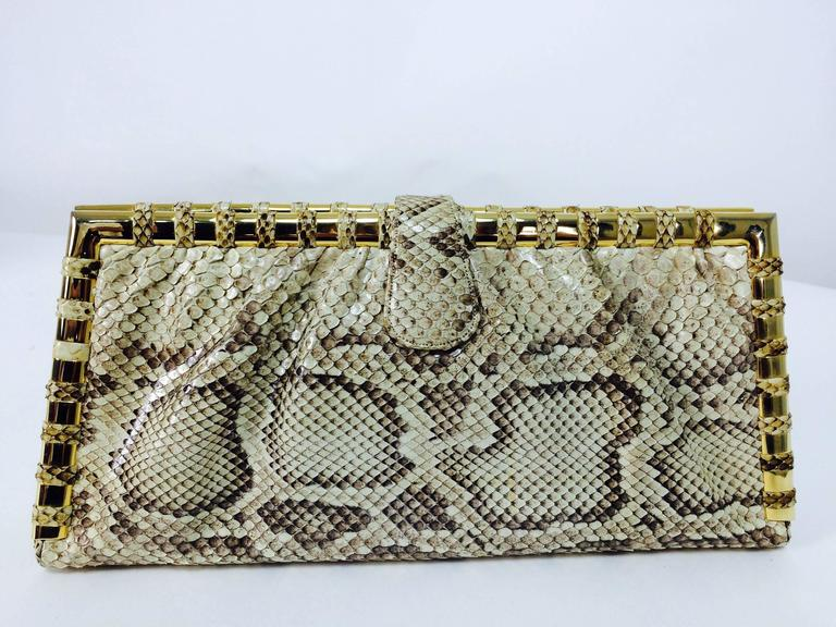 Judith Leiber natural python gold frame snake chain handbag or clutch...Gold frame handbag carry as clutch or shoulder bag...Sleek bag with gold metal frame that is wrapped in bands of snakeskin...With optional double gold snake chanin...Lined in