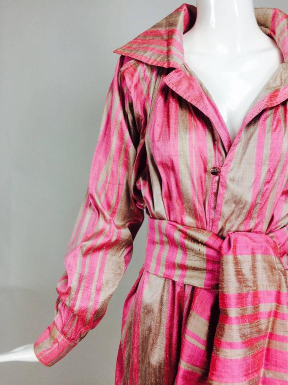 Vintage raw silk pink/bone shift dress with wide waist wrap 1970s...Casually elegant with bohemian flare, from the 1970s, this dress has style...Pull on dress with long raglan sleeves that have button cuffs...The neckline has a wide flared notched
