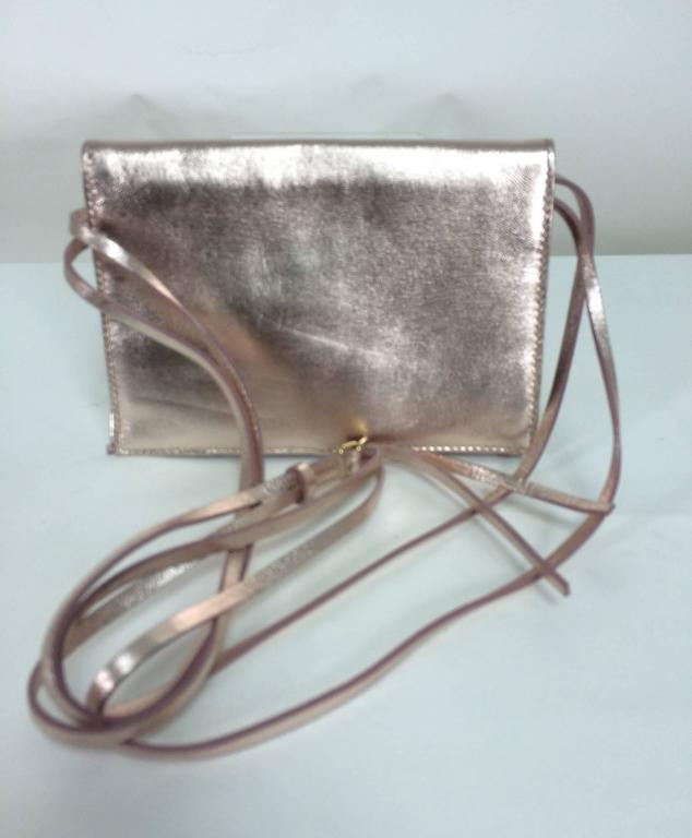 Vintage Baccarat Eclipse pale pink metallic leather with crystal shoulder bag...New in the box...This bag can be worn as a shoulder bag or carried as a clutch...Multi strand metallic leather shoulder strap has a gold adjustable buckle...Fold over