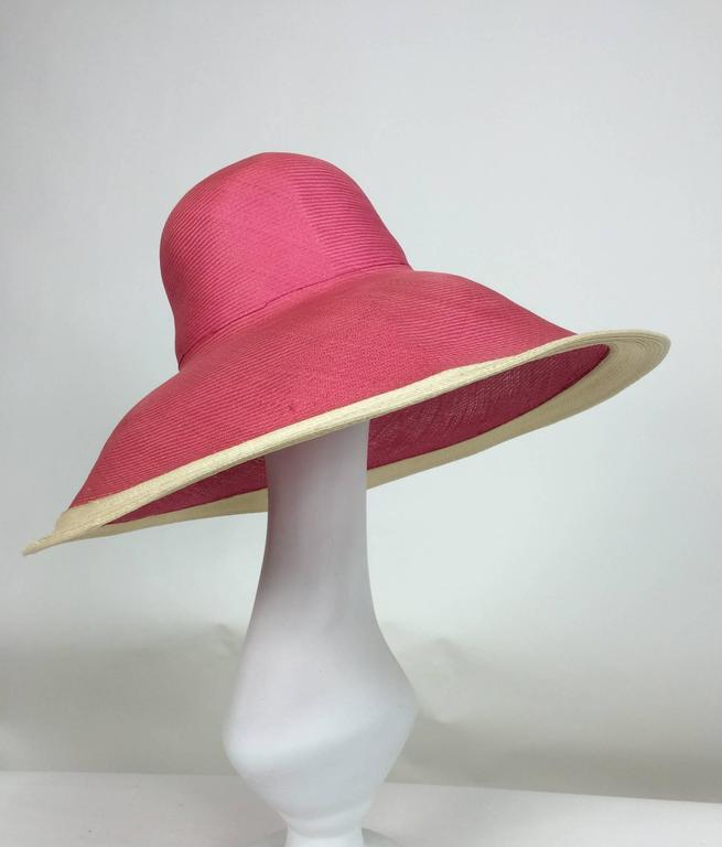 Deep brim finely woven straw hat with a high crown...The brim is meant to be turned down, the edge band is trimmed in natural straw...Unworn  In excellent wearable condition... All our clothing is dry cleaned and inspected for condition and is