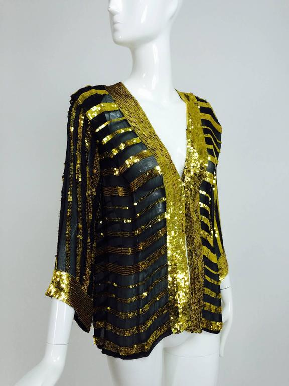 From the late 1970s a Sweelo black silk chiffon kimono style jacket with horizontal bands of bright gold sequins...The front facings and jacket cuffs all have a wide band of sequins...Open front jacket, unlined...Unworn...Fits like a size