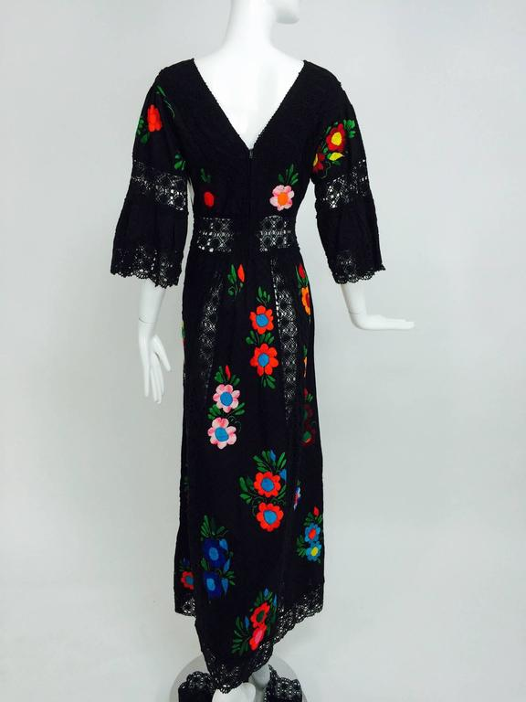 Vintage colourfully embroidered black cotton & lace Mexican maxi dress 1970s For Sale 1