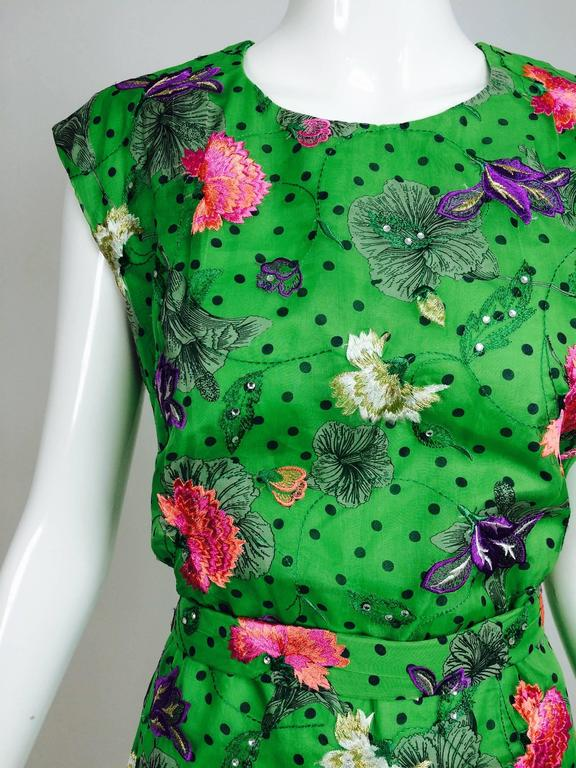 1990s custom made one of a kind, gorgeous grass green embroidered organdy sheath dress...Sleeveless dress with a round neckline...Semi fitted with center back hem vent...A beautifully made dress of exquisite grass green silk organdy that is printed