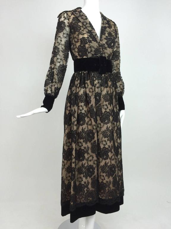Classic shirt waist style dress from the 1970s. Dress closes at the front with hidden covered snaps. Wide collar lays flat to create a deep neckline. Long sleeves with black velvet cuffs that close with hidden snaps at the wrist. The skirt is