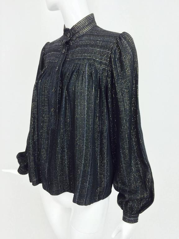 Vintage Yves Saint Laurent YSL black metallic stripe gauze peasant top from the 1970s...Long sleeve blouse has full sleeves with button cuffs...Yoke front and back with button front placket, the blouse falls semi full below yoke...Band collar...Fits