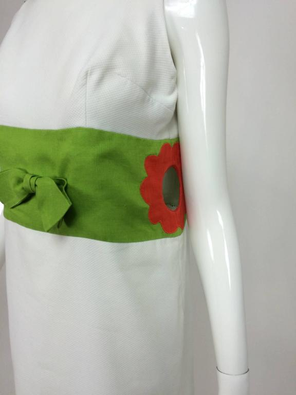 Vintage mod style novelty white pique maxi dress with open flower sides 1960s...Iconic mid 60s maxi dress that could be seen, in the day, on shows like