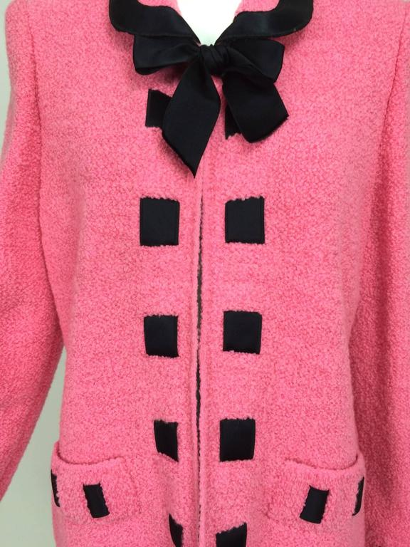 Vintage Adolfo pink & black ribbon trim boucle jacket 1970s...Loose fitting jacket closes at the neck front with a hidden hook and a black satin bow tie (snaps on), the jacket is open below with no fastenings...Trimmed in black satin woven ribbon at