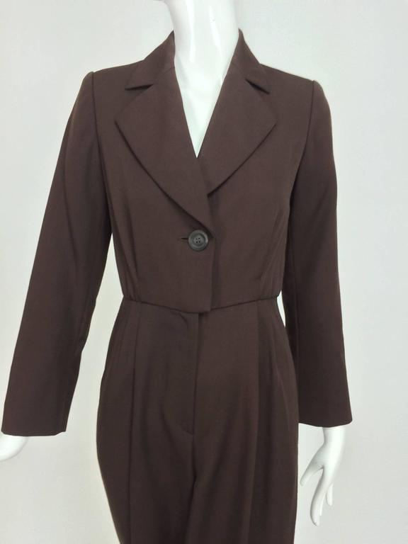 Vintage Yves Saint Laurent YSL brown wool tuxedo jumpsuit 1970s...One piece jumpsuit with the look of a tuxedo/le smoking...Step in, single button at the front with a deep V neckline and notched lapels...Long sleeves with single button cuffs...The