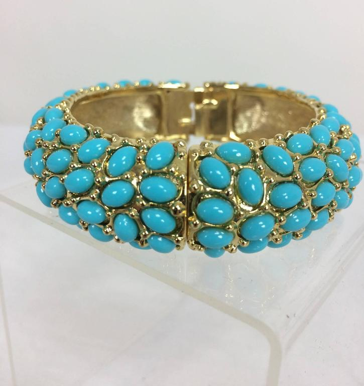 "Kenneth Lane turquoise cabochon encrusted gold clamper bracelet...Approximately 3/4"" high X 3"" across, excellent."
