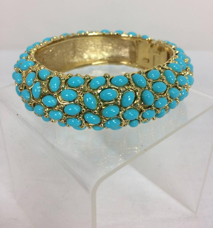 Women's Kenneth Lane turquoise cabochon encrusted gold clamper bracelet For Sale