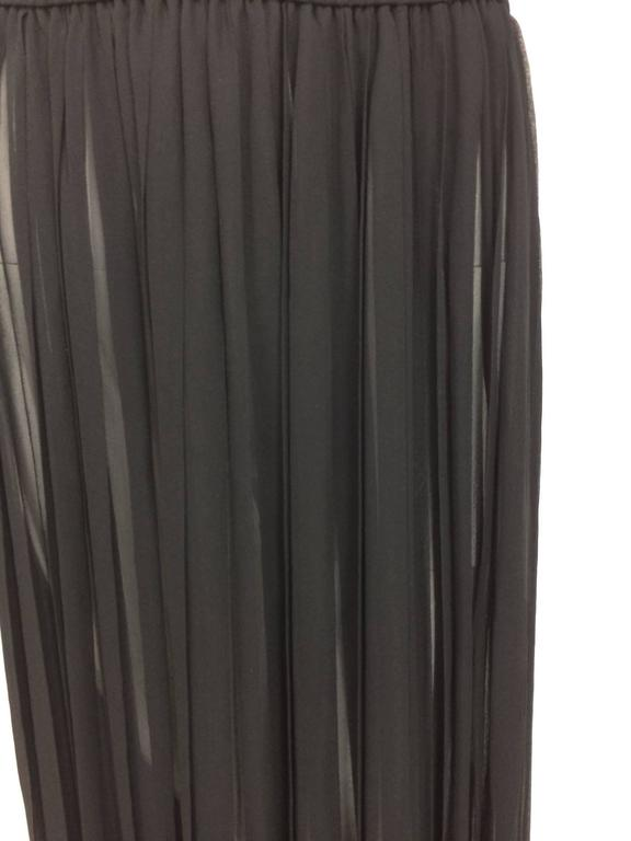 Vintage Yves St Laurent knife pleated sheer silk chiffon maxi skirt 1970s...Cased elastic waist...Sexy sheer silk chiffon...Marked size 38  In excellent wearable condition... All our clothing is dry cleaned and inspected for condition and is ready