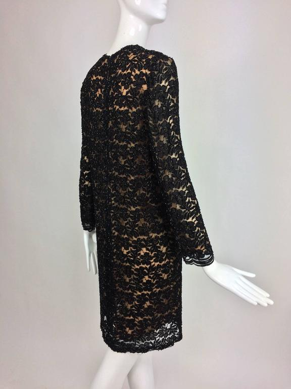 Vintage mod style beaded black floral lace nude lined cocktail dress 1960s In Excellent Condition For Sale In West Palm Beach, FL