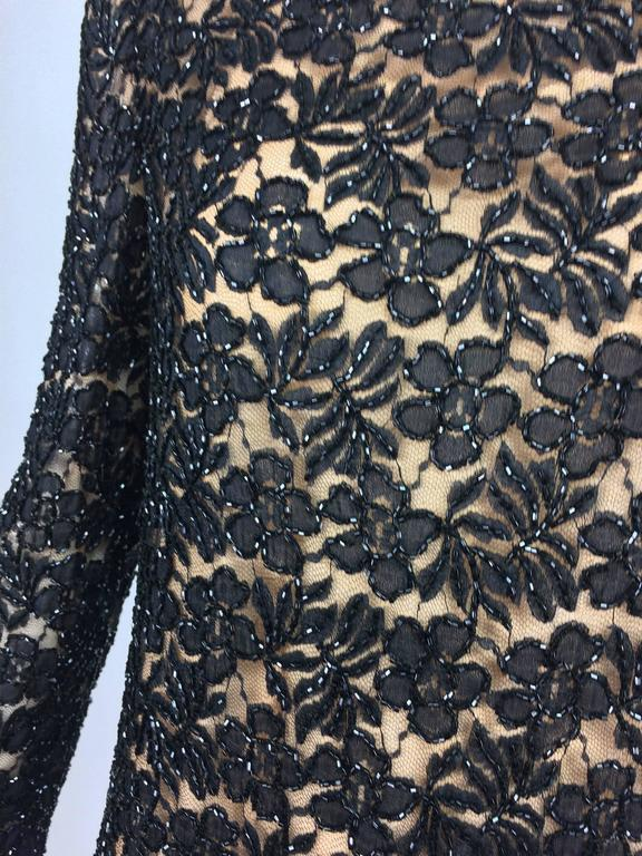 Women's Vintage mod style beaded black floral lace nude lined cocktail dress 1960s For Sale