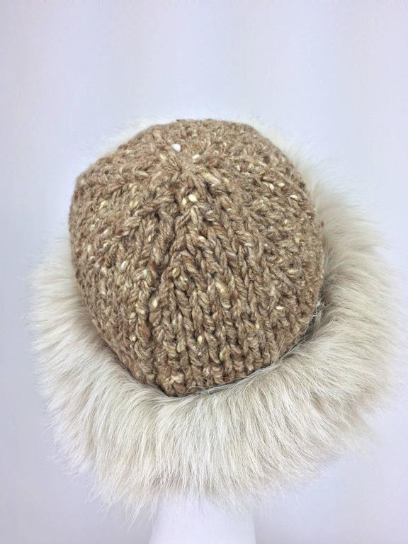 Lillie Rubin Fox fur and tweed knit hat 1970s unworn...A chunky knitted cap (feels like a wool blend), is trimmed with a wide band of cream fox fur...Knit stretches...Fits a size medium. In excellent unworn condition