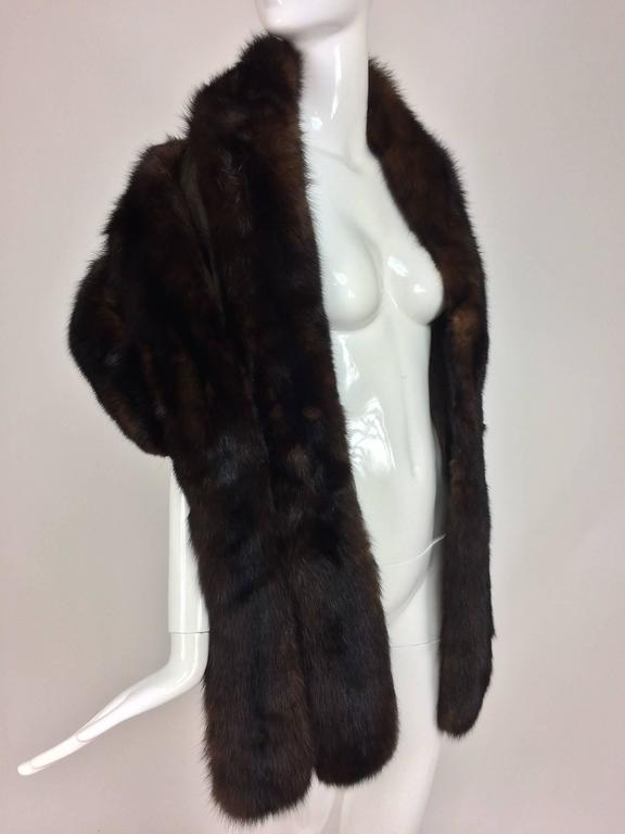 Sable cape drape and wrap style full and lush 1960s...Dark full and lush sable cape from the early 1960s...Done in wide horizontal bands of fur...The front panels are wide and long and great for wrapping over your shoulders...Fully lined in brown