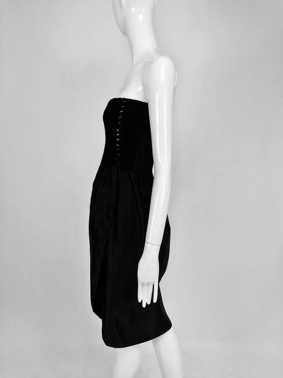 Lanvin numbered Haute Couture cocktail dress...From the late 1970s or early 1980s...Strapless, black crushed silk velvet bodice dress, closes at the side with cone shaped glossy black buttons and hand made loops, the bodice is boned and fully lined