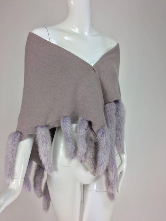 Lavender soft wool and angora knit shawl with mink tails...Triangular shawl is double thickness, it is trimmed on 3 sides with mink tails, the knit shawl is pale lavender and the mink tails are a coordinating shade of lavender...In very good