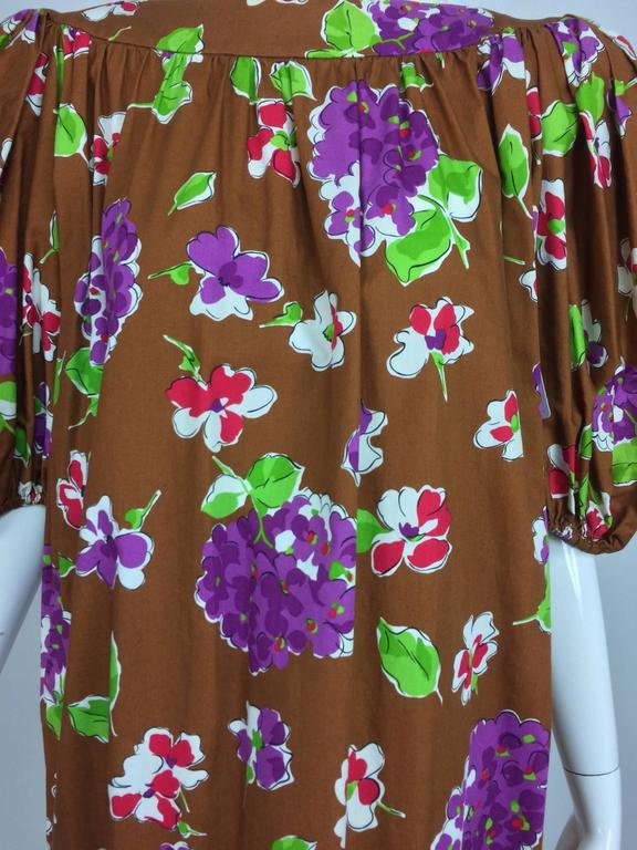 Vintage Yves Saint Laurent floral cotton sac dress 1980s...Chocolate brown cotton printed with vibrant flowers in purple, red, cream and green...Pull on sac dress has a bateau neckline and is slightly gathered below the dress is full through the